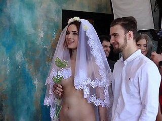 Nude bride clothed groom